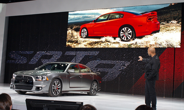 Chrysler's SRT brand CEO Ralph Gilles introduces the Dodge Charger SRT8 at the 2011 Chicago Auto Show - Photo by Randy Stern