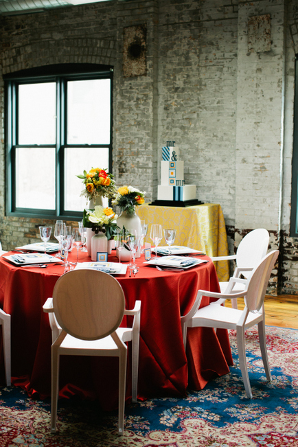 Tablecloths, tableware, and decor by Après Party and Tent Rental. Acrylic Chairs from BeThings. Photo by Photogen Inc.