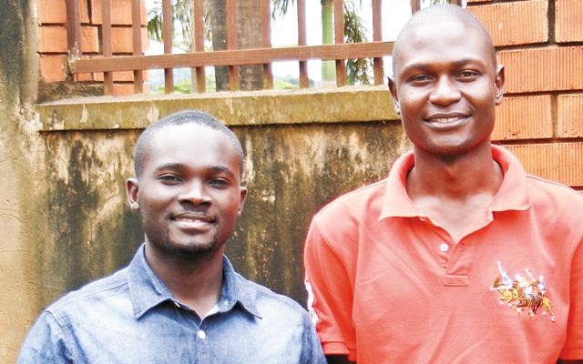 Andrew (blue shirt, an ardent Ally and Bishop Senyonjo's nephew) is the Programs Director at SPREC; Moses (red shirt) is an Ally and a faith-based activist. Photo courtesy of David R. Weiss