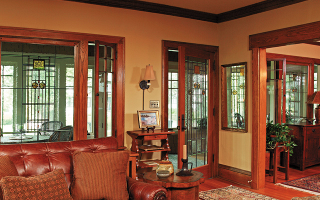 Art glass windows and full-view interior front door better connect the porch to the interior and bring more light into the living room.