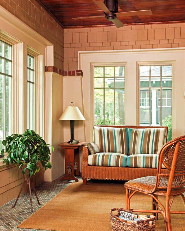 The porch accommodates a seating area as well as informal dining that Mark loves to use for his studies.