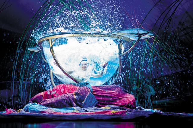 Miranda in the 6000-lb water bowl. Photo courtesy of Cirque du Soleil - Amaluna