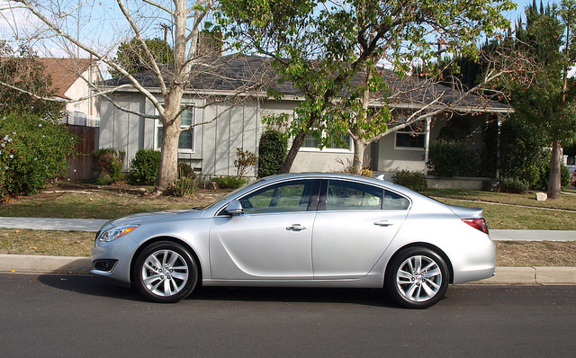 The 2014 Buick Regal in front of the house where Randy grew up.