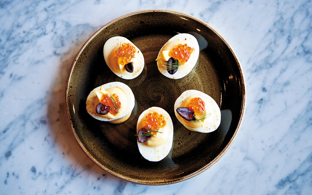 Not your Grandma's recipe: Another tasty bite is the Deviled Eggs. The eggs are accompanied by smoked caviar-tasting trout eggs hit with a touch of cumin salt and a dash of lemon and dill. Photo by Hubert Bonnet