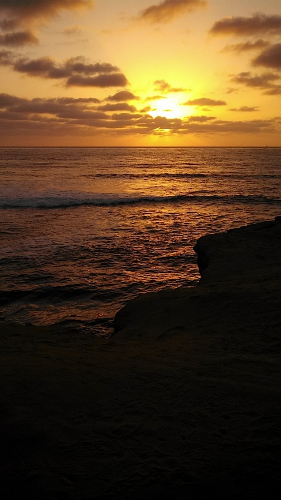 Sunset at the famous Sunset Cliffs sets a romantic mood. Photo by Krissy Bradbury.