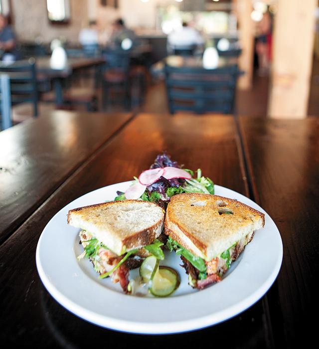 Farmhouse BLT. Nothing like my granny ever made.  Thick-cut bacon slab which has been smoked on the premises and sits on top of country bread. Garnished with butter lettuce, tomato, white cheddar, and chive aioli. I'm sure this would take the edge off any hangover. Photo by Hubert Bonnet