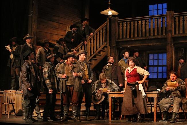 Claire Rutter and the cast of La Fanciulla del West. Photo by Michal Daniel