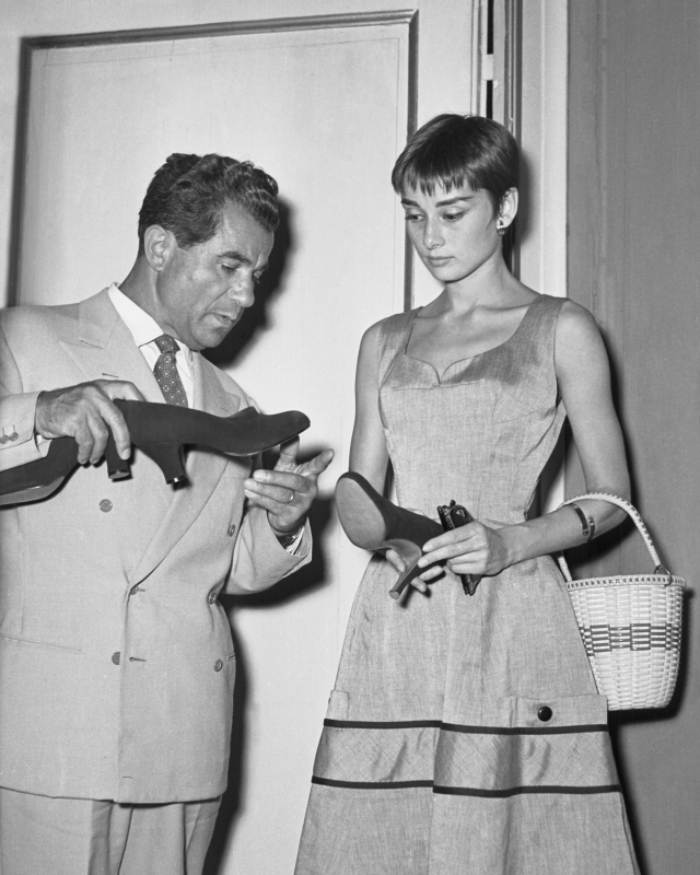 Salvatore Ferragamo with Audrey Hepburn at Palazzo Spini Feroni in Florence, 1954. © Banca Dati dell'Archivio Storico Foto Locchi Firenze