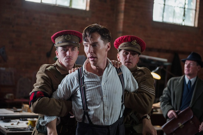 Benedict Cumberbatch, as Alan Touring, is forced out of the office.   Photo courtesy of The Weinstein Company