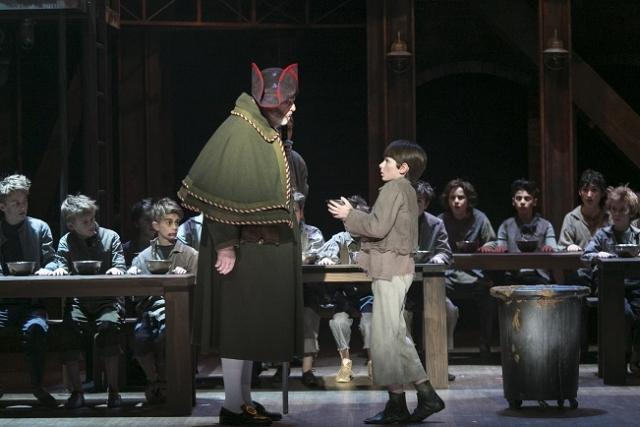 Jim Ramlet as Mr. Bumble and Nate Turcotte as Oliver Photo by Heidi Bohnenkamp