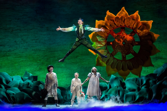 John (Christian Tesch),  Michael (Gavin Nienbauer), and Wendy Darling (Alanna Saunders) arrive in Neverland with Peter Pan (Tyler Michaels). Photo by Dan Norman