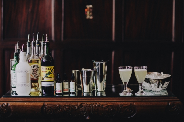 The Gimlet includes Easy & Oskey Bitters, Dry Gin, Pink Peppercorn Simple Syrup, and Fresh Lime Juice, shown here. Photography by Matt Lien Photography