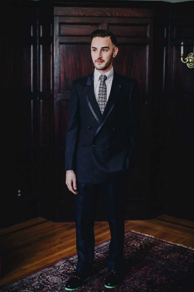 """Custom upcycled double-breasted navy blue tuxedo with satin trim ($225) from Dapper Dan Michael; """"Grown Man Solar Red"""" resoled Florsheim shoes with green glow bricklayer sole by Greenwich Vintage Co. Photography by Matt Lien Photography"""