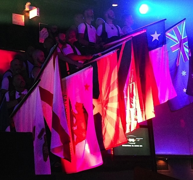 IML contestants holding flags at Friday evening's IML opening ceremonies. Photo by Steve Lenius.