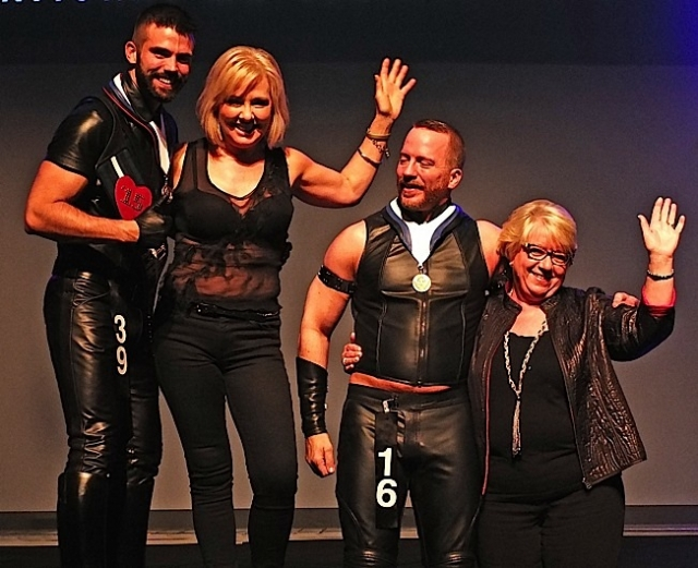 Patrick Smith and Brian Donner pose with their IML Moms. Photo by Steve Lenius.