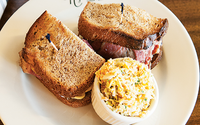 A tower of tender pastrami. Photo by Hubert Bonnet
