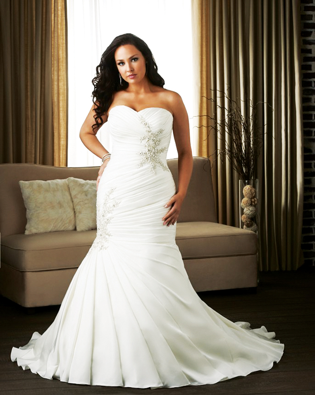 Style 1309. This fitted lace-up gown has a soft sweetheart strapless neckline. Pleating wraps around this form fitting silhouette with strongly beaded lace accents placed asymmetrically from one another. Photo courtesy of Bonny Bridals Unforgettable