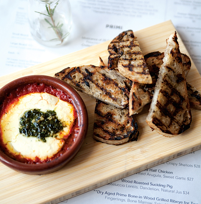 Wood Baked Goat Cheese with herbs, tomato fondue, and olive toast.