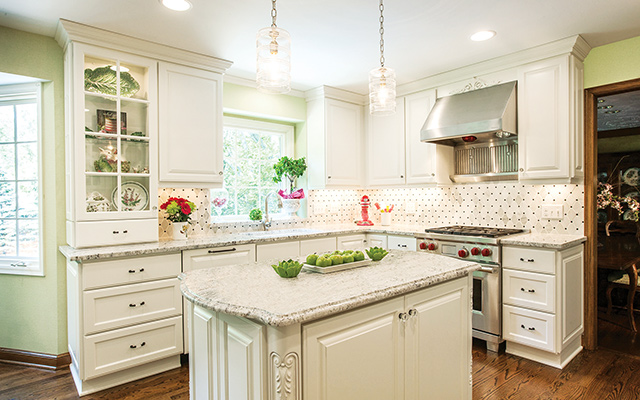 Mix-and-match wood is a trend seen throughout many homes on the tour. This mix of white cabinets and dark floors add an unexpected touch of panache. Photo courtesy of Crystal Kitchen Center