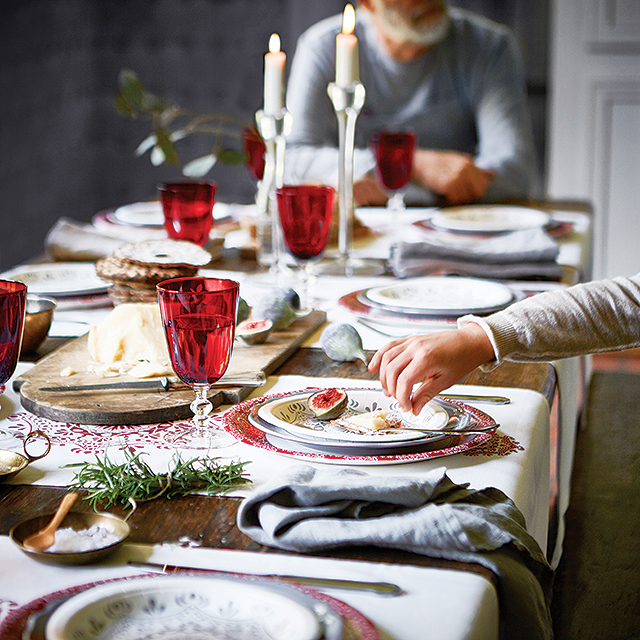 Paper plates never looked so good! Colorful wine glasses and Ikea's neutral Vinter 2015 table runners ($6.99 each) placed horizontally create a festive, yet elegant tablescape.