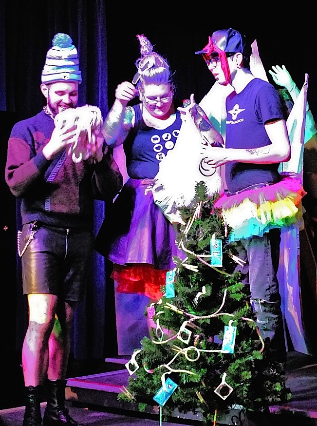 The Queens from Queensland decorating their tree. Photo by Steve Lenius.