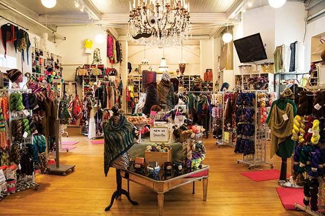 Steven Berg bought the building to house his yarn shop mostly because it could handle his giant chandelier.