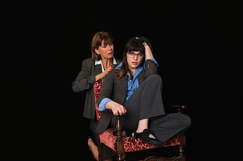 Caroline Kaiser (kneeling) & Molly Pach (seated). Photo by Richard Fleischman.