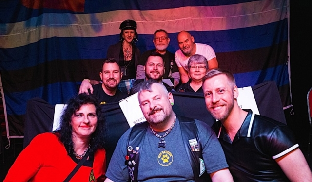 At Kinky Squares, the afternoon's second set of leather celebrities. Front row: Sue Olson, Pup Bruizer and Ryan Brown; middle row: Derek Harley, Steven Patton and PJ Knight; back row: Mikalya Stanek, Sam Carlisle and Marc DeBauch. Photo by Andrew Bertke.