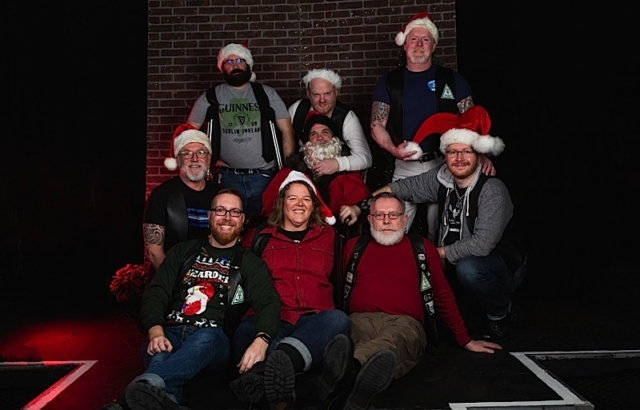 """At """"The Nightmare of Christmas,"""" members of the Atons of Minneapolis surround Kinky Santa. Photo by Andrew Bertke."""