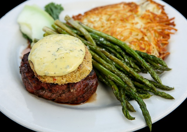Steak Spaulding topped with crab cake and béarnaise sauce