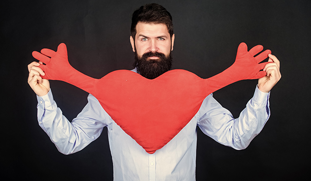 Make him feel loved every day. Man bearded hipster hug heart. Celebrate valentines day. Guy with beard and mustache in love romantic mood. Feeling love. Dating and relations concept. Happy in love